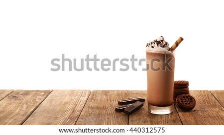 Delicious milkshake with chocolate and cookies, isolated on white - stock photo
