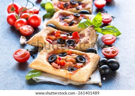 Delicious mini pizza on the table,selective focus  - stock photo