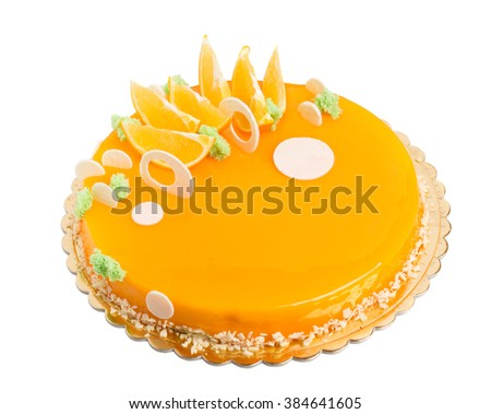 Delicious mirror glazed orange cake. Decorated with sliced orange and white chocolate. Isolated on a white background. - stock photo
