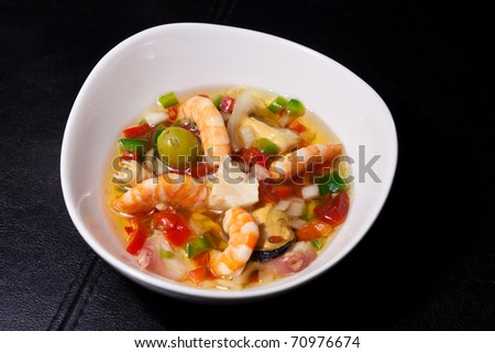 Delicious mixed seafood with octopus, shrimps, mussels in vinaigrette sauce. Clipping path - stock photo