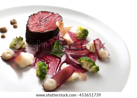 Delicious modern veal fillet served with sauce. Molecular cuisine with steak. - stock photo