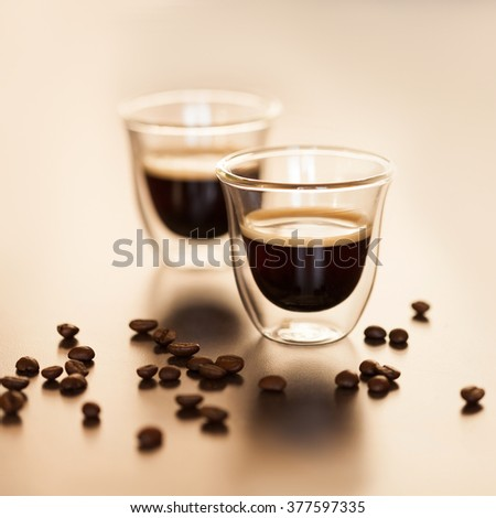 delicious morning espresso in a transparent cup - stock photo