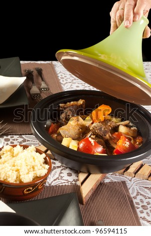 Delicious moroccan tajine dish and fresh couscous - stock photo