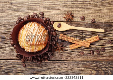 Delicious muffin on vintage wooden table. Top view - stock photo