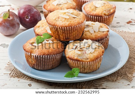Delicious muffins with plums and almond crumble - stock photo