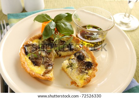 Delicious mushroom quiche with balsamic dressing. - stock photo