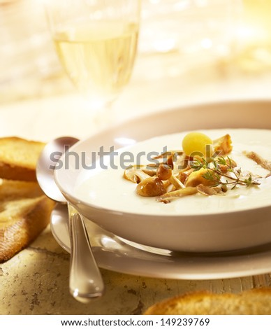 delicious mushroom soup with bread and wine - stock photo