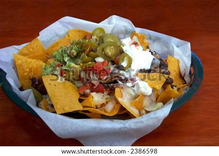 Delicious nachos in a basket - stock photo