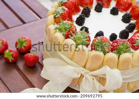 Delicious no bake strawberry cream cake Charlotte - stock photo