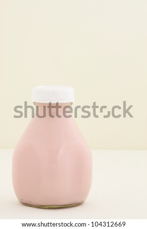 Delicious, nutritious and fresh Strawberry milk pint, made with organic real strawberry fruit - stock photo