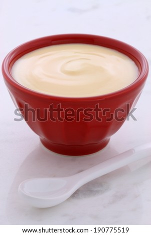 Delicious, nutritious and healthy fresh banana yogurt on vintage carrara marble. - stock photo