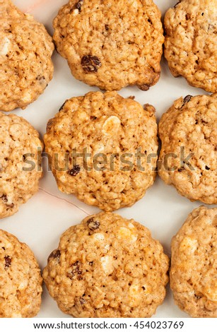 Delicious oatmeal cookies with raisins and peanuts - stock photo