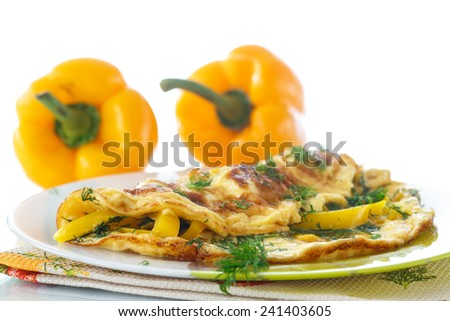 delicious omelet with peppers and herbs on a plate - stock photo