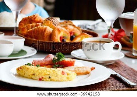 Delicious omelette with vegetables served for breakfast - stock photo