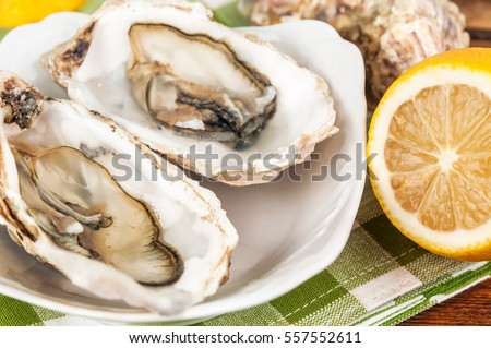 delicious opened oysters and lemon
