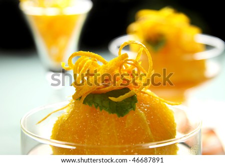 Delicious orange dessert with syrup topped with orange rind.