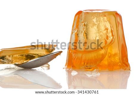Delicious orange gelatin on a white background. - stock photo