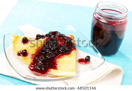 Delicious pancake with forest fruit jam