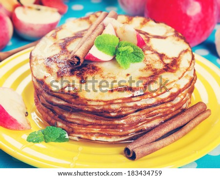 Delicious pancakes, honey apples and cinnamon. Vintage retro hipster style version - stock photo