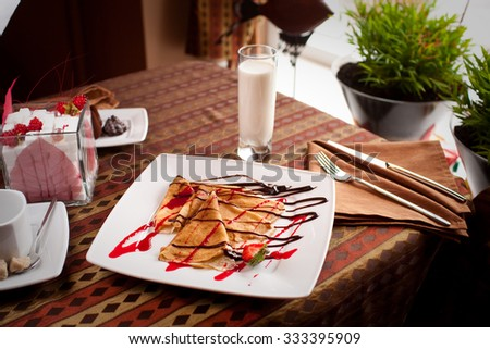 delicious pancakes on a white plate - stock photo