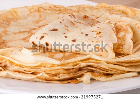 Delicious Pancakes on Plate Served, Isolated on White Wooden Table - stock photo