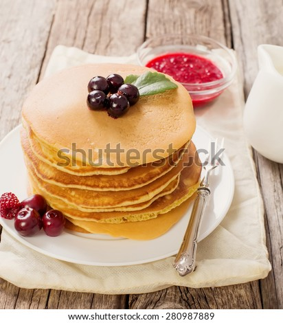 delicious pancakes on wooden table with fruits - stock photo
