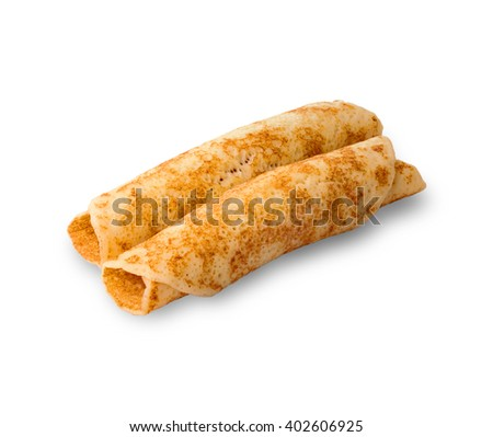delicious pancakes rolled in a roll on white background