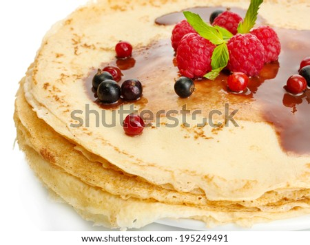 Delicious pancakes with berries and chocolate on plate isolated on white