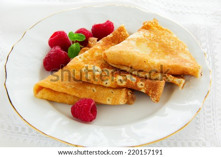 Delicious pancakes with berries and honey - stock photo