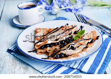 Delicious pancakes with blueberries on table close-up - stock photo