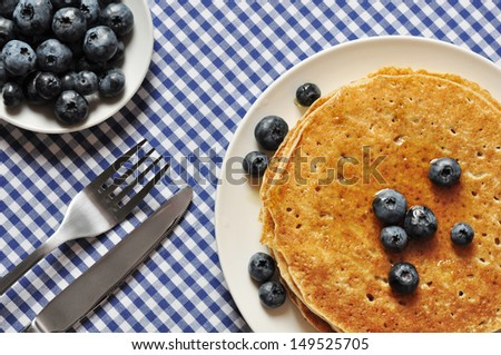 Delicious pancakes with fresh blueberries and maple syrup - stock photo