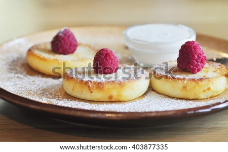 Delicious pancakes with sauce on the wooden kitchen  - stock photo