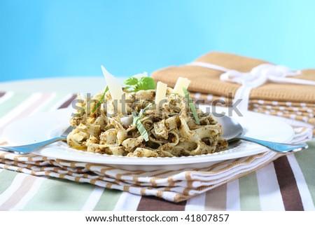 delicious pasta with pesto sauce, narrow focus - stock photo