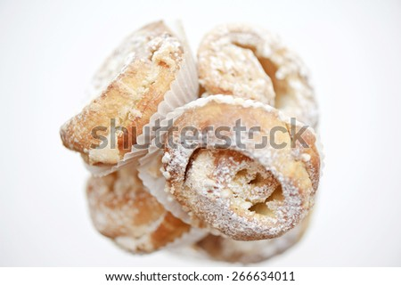 Delicious pastry with icing sugar - stock photo