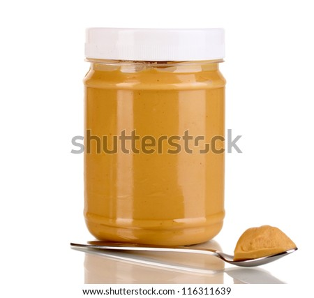 Delicious peanut butter in jar isolated on white - stock photo