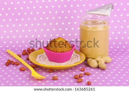 Delicious peanut butter with cake on purple background with polka dots