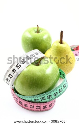 delicious pear and green apple and measure isolated on white