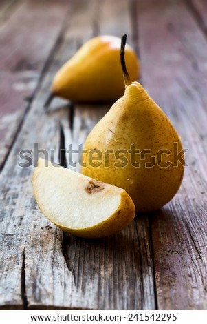 Delicious pear over rustic wooden background. Close up. Selective focus. - stock photo