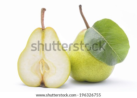 Delicious pear with green leaves