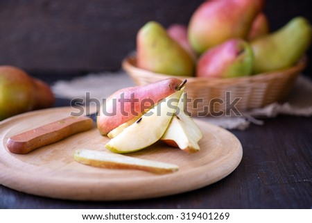 Delicious pears on a rustic wooden kitchen table - stock photo