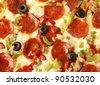 Delicious pepperoni pizza background - stock photo