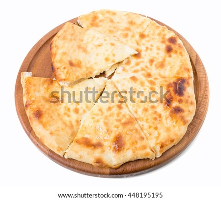 Delicious pie stuffed with cottage cheese. Isolated on a white background.
