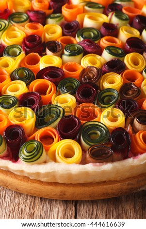 Delicious pie summer vegetables: carrots, beets, zucchini and eggplant close up on the table. Vertical - stock photo