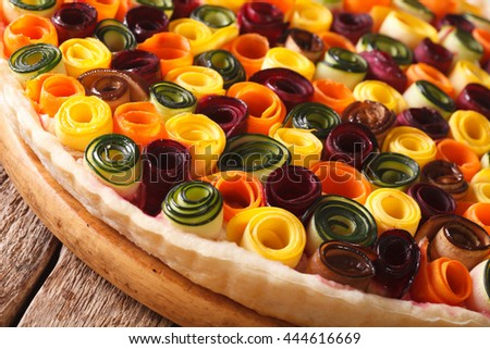 Delicious pie summer vegetables: carrots, beets, zucchini and eggplant close up on the table. Horizontal - stock photo