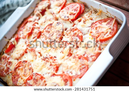 Delicious pie with tomato and grated cheese coating  - stock photo