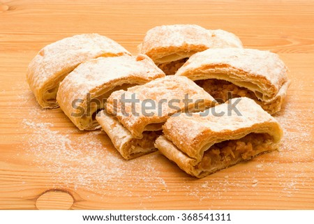 delicious pieces of apple strudel on wooden table - stock photo