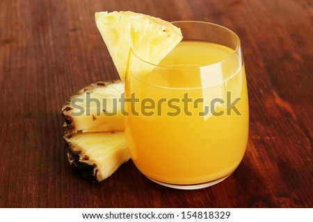 Delicious pineapple juice on table close-up - stock photo