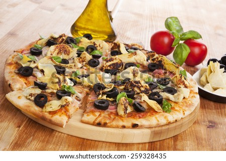 Delicious pizza background. Fresh pizza, olive oil, on wooden background. Culinary pizza eating. - stock photo
