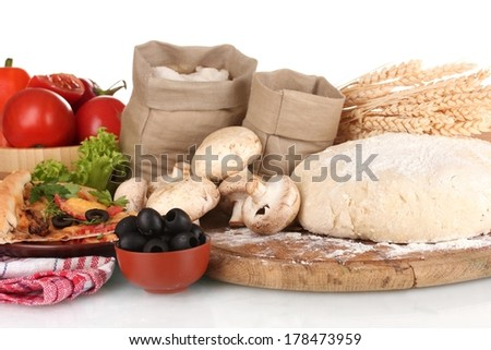 delicious pizza, dough and vegetables isolated on white - stock photo