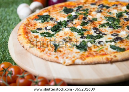 Delicious pizza which you can eat even on a diet. Only high quality and low fat products like spinach and feta cheese.  - stock photo